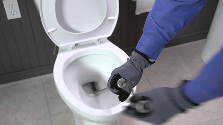 How Plumbers Unclog a Toilet